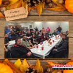 Employees sitting at Thanksgiving tables.