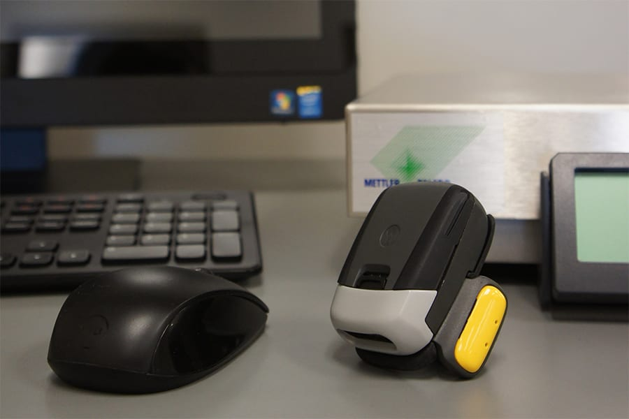 Close-up of Champ ring-scanner, computer monitor, mouse, and scale.