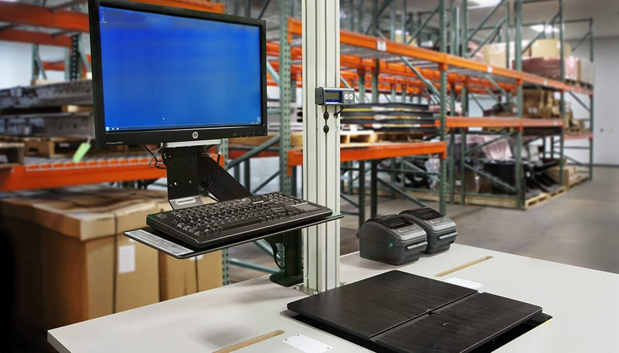 Close-up of an EZ-WorkDesk desktop in a warehouse.