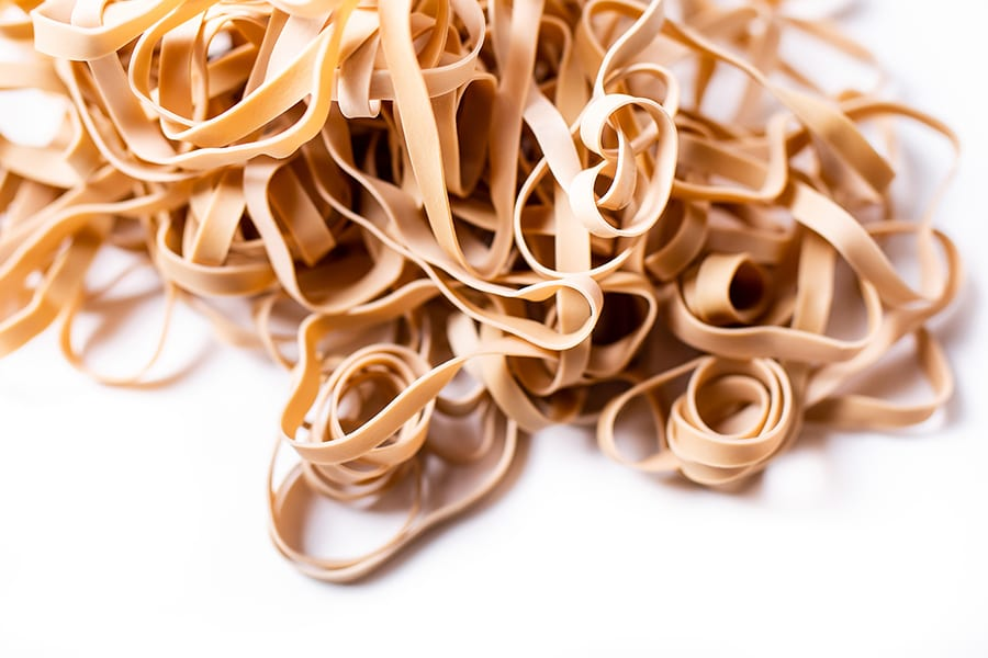 A pile of rubber-bands on a white background.